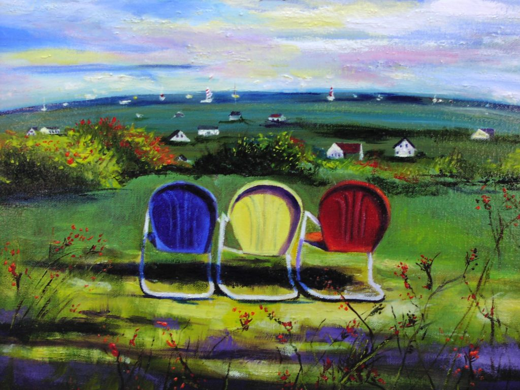 Three lawn chairs lined up facing a seaside landscape.
